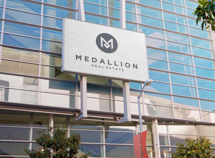 Medallion Sign on Building